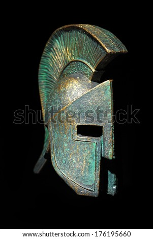Ancient Greek Helmet Sparta Style in Low Key - stock photo