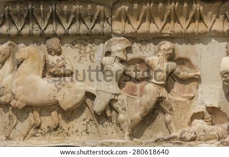 Ancient Greek Temple Frieze detail, Delhpi, Greece - stock photo