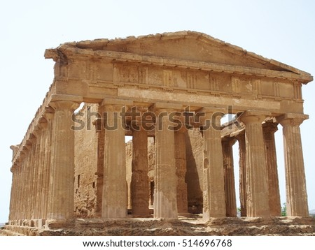 Ancient greek temple of Concordia in Valley of the Temples with cloudy sky in warm and sunny spring day: AGRIGENTO, SICILY / ITALY - MAY 2016.