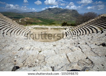 ancient Greek theatre, panorama view of beautiful mountains from the last row, Segesta village, Sicily, Italy - stock photo