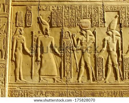 Ancient hieroglyphics on the wall of Kom Ombo temple, Egypt - stock photo