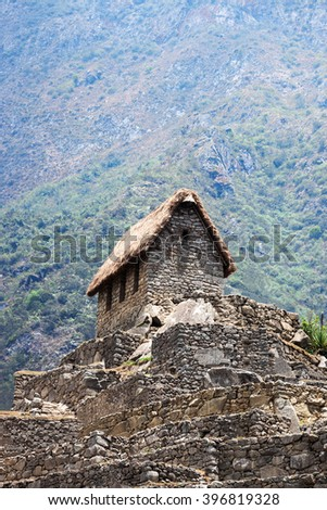 ancient house in Machu Picchu mountains in the background - stock photo