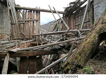 Ancient House in ruins and abandoned with the roof destroyed in the mountains - stock photo