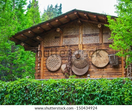 Ancient house of ethnic minorities, located in Yunnan Nationalities Village,  Kunming City, Yunnan Province, China.  - stock photo