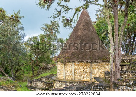 Ancient house with a thatch roof in the ruins of Kuelap, Peru - stock photo