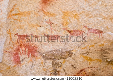 Ancient hunting scene painted in a cave in Patagonia, Southern Argentina. - stock photo