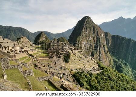 Ancient Inca dwellings in Machu Picchu, Peru - stock photo