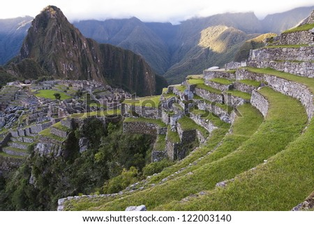 Ancient Inca lost city Machu Picchu in the evening. - stock photo