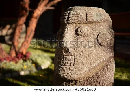Ancient Incas head sculpture located outdoor, Cusco, Peru - stock photo