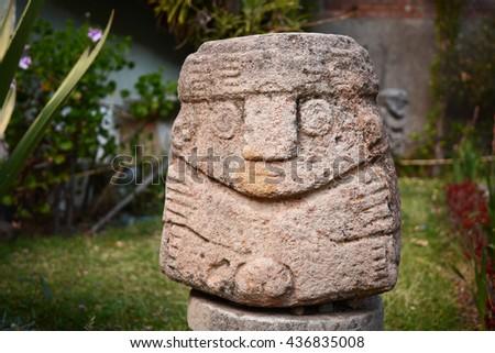 Ancient Incas head sculpture located outdoor, Cuzco, Peru - stock photo
