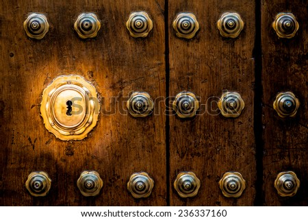Ancient Italian door (estimated 200 years old) in Tuscany. Keyhole useful for concepts. - stock photo