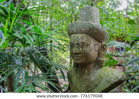 Ancient Khmer Art Statue in Jungle