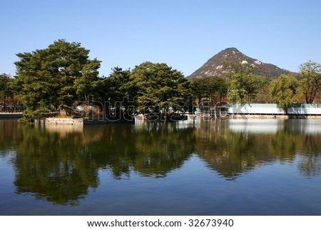 Ancient korean temple built on a pond.