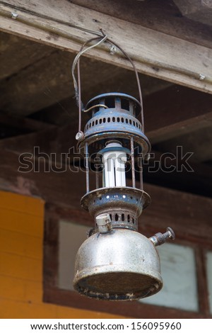 Ancient lamp bulb applied to modern - stock photo