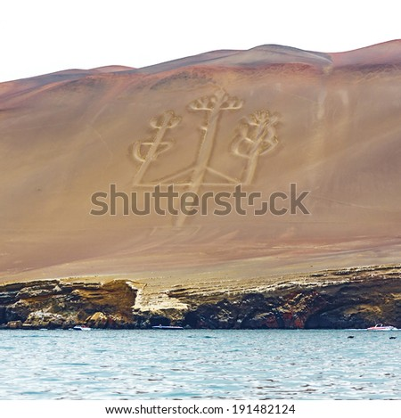Ancient large-scale geoglyph Candelabrum figure in Paracas national park. It is a designated UNESCO World Heritage Site - Peru, South America - stock photo