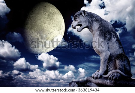 Ancient lion statue and bright moon in the night sky. Elements of this image furnished by NASA - stock photo