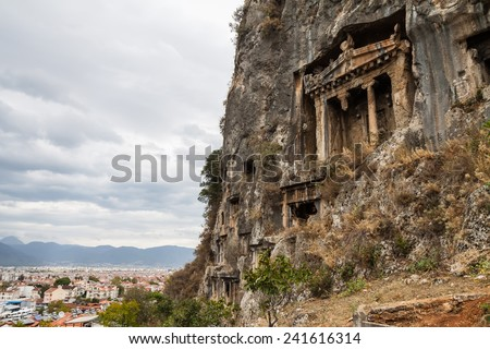 Ancient Lycian Rock Tombs in Fethiye, Turkey - stock photo