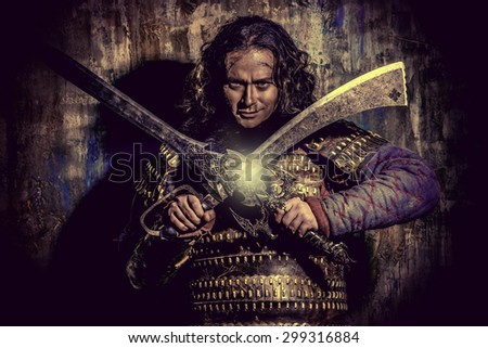 Ancient male warrior in armor holding sword. Historical character. Fantasy. - stock photo