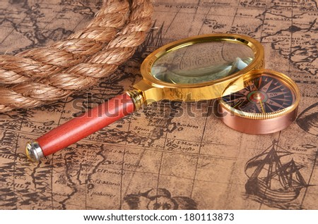 ancient map and magnifying glass