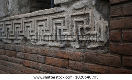 ancient marble decorations on brick wall