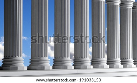 Ancient marble pillars in a row with blue sky - stock photo