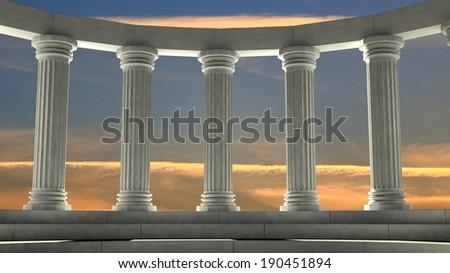 Ancient marble pillars in elliptical arrangement with orange sky - stock photo