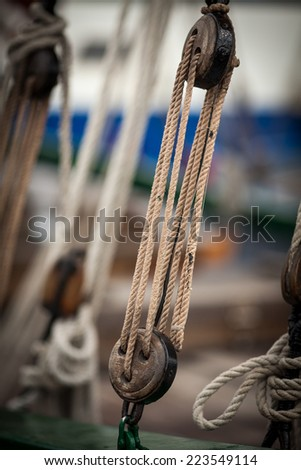 Ancient marine pulleys with rope - stock photo