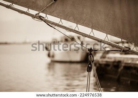 Ancient mast and sails with sepia tone - stock photo