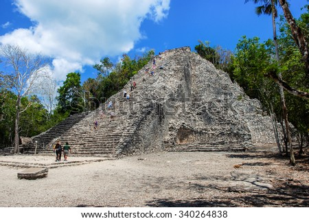 Ancient mayan city Coba in Mexico. Its archaeological area is a famous landmark of Yucatan Peninsula. Cloudy sky - stock photo