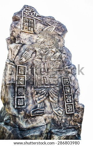 Ancient Mayan hieroglyphics in stone, from the ruins over white background  - stock photo