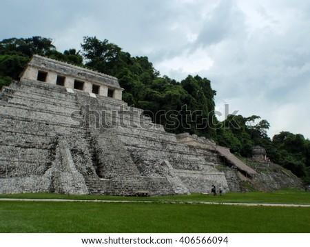 Ancient Mayan pyramid at Palenque ruins in Mexico - stock photo