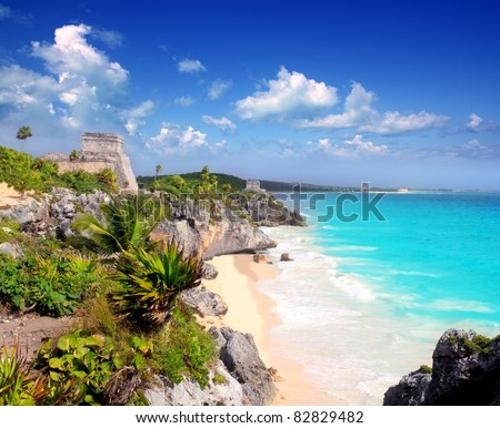 ancient Mayan ruins temple of Tulum in Caribbean turquoise sea shore - stock photo