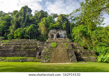 Ancient Mayan temple in the ruins of Palenque in Chiapas, Mexico - stock photo