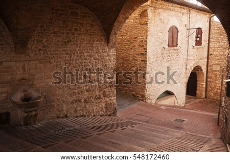 Ancient medieval alley in Assisi, Italy.