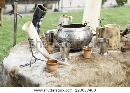 Ancient medieval bowls, detail of old containers - stock photo
