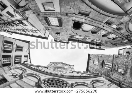 Ancient medieval city buildings of Lucca, Tuscany. Fisheye view. - stock photo