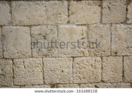 Ancient Medieval Stone Block Wall Background - stock photo