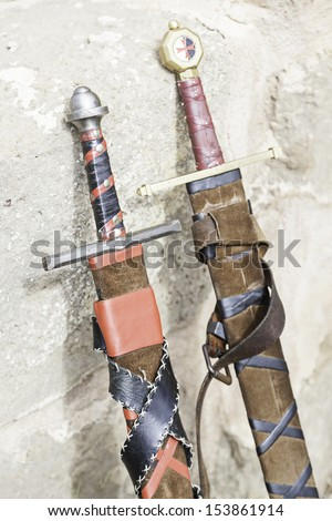Ancient medieval swords, edged weapons detail to kill, a tool of war and destruction, death - stock photo
