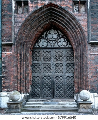 Ancient metal door with portal of gothic church & Ancient Metal Door Portal Gothic Church Stock Photo (Safe to Use ...