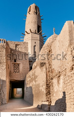 Ancient minaret of Ayyubid Mosque in the village of Al Qasr, Dakhla Oasis, Egypt. - stock photo