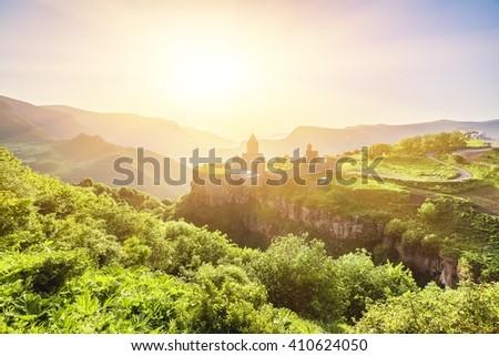Ancient monastery in setting sun. Tatev. Armenia - stock photo