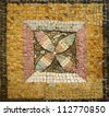 Ancient mosaic ornament with a flower yellow, black, red and green - stock photo