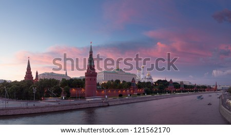 Ancient Moscow Kremlin and the Moscow river in light of setting sun, Russia. - stock photo