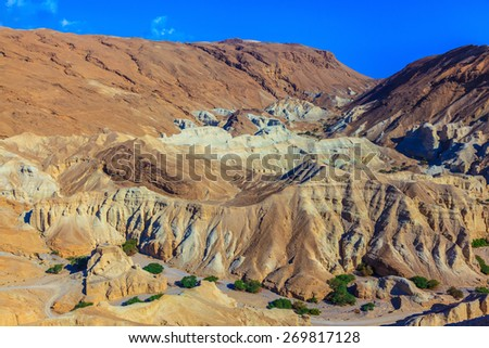 Ancient mountains in the valley of the Dead Sea. Picturesque multi-colored taluses dry sandstone - stock photo