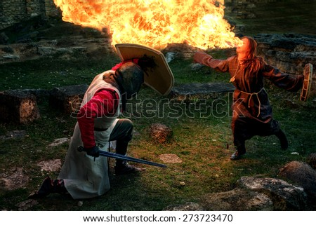 Ancient mystic knights battle with witch - stock photo