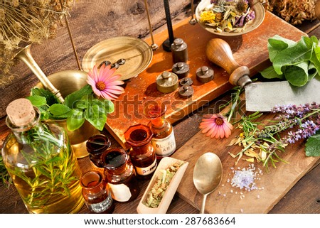 Ancient natural medicine, herbal, vials and scale on wooden background - stock photo