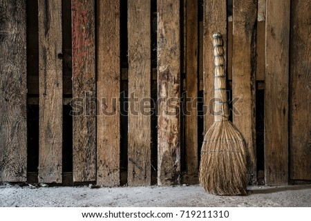 Ancient natural, old straw broom, which wiped rooms, yards and streets. Basement or cellar general cleaning. Retro vintage atmosphere.