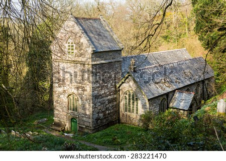 Ancient norman parish church in woodland in Minster, Boscastle, Cornwall, England, UK - stock photo