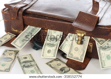 Ancient old suitcase full of banknotes - stock photo