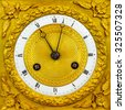 Ancient ornamental golden clock face with white base plate - stock photo